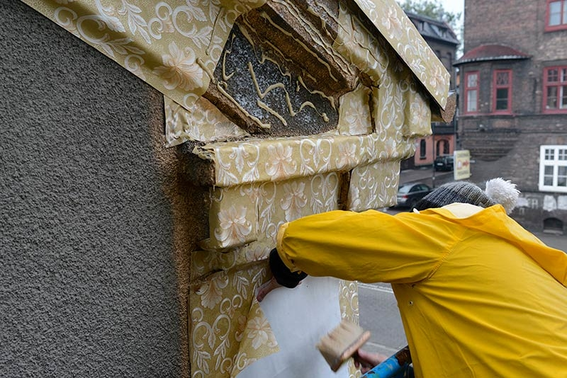 Artist Ian Strange covers historical building in over 600 sq metres of gold wallpaper