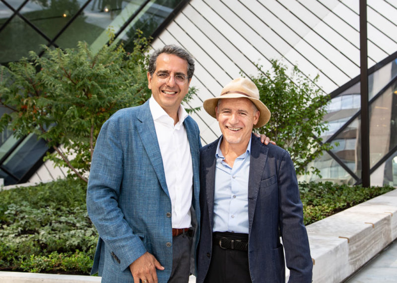 Siamak Hariri and Ron Holbrook standing infront of planters on the Reed Family Plaza