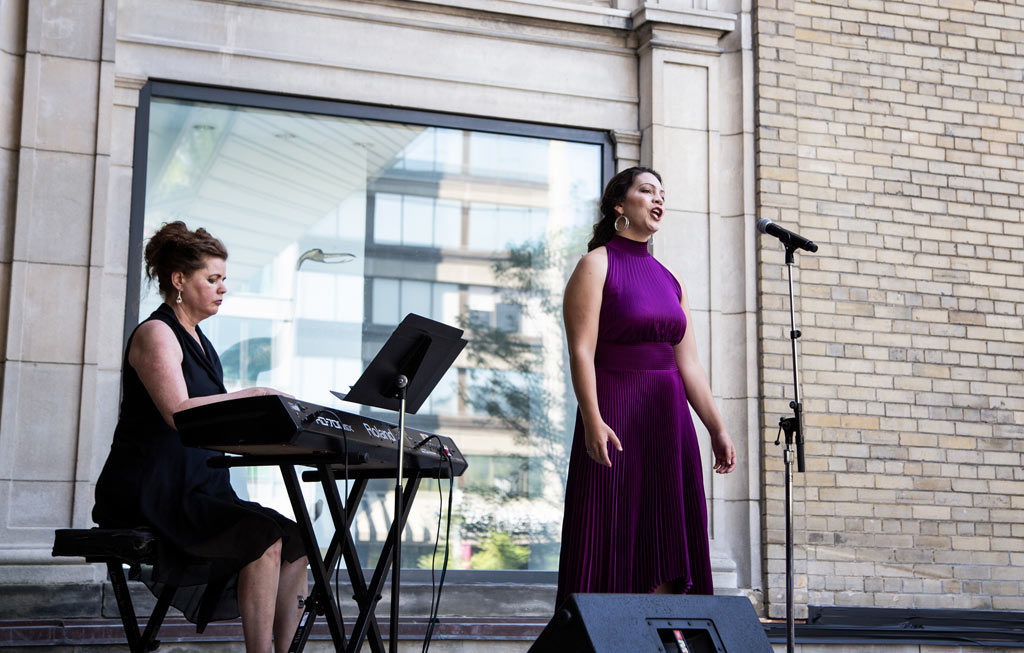 Jennifer Routhier performs onstage at the Helga and Mike Schmidt Performance Terrace