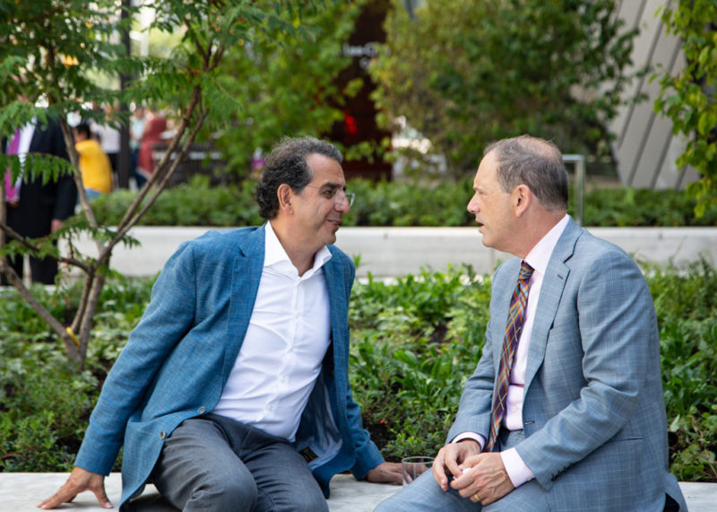 Siamak Hariri and Josh Basseches enjoying a quite moment on the Reed Family Plaza