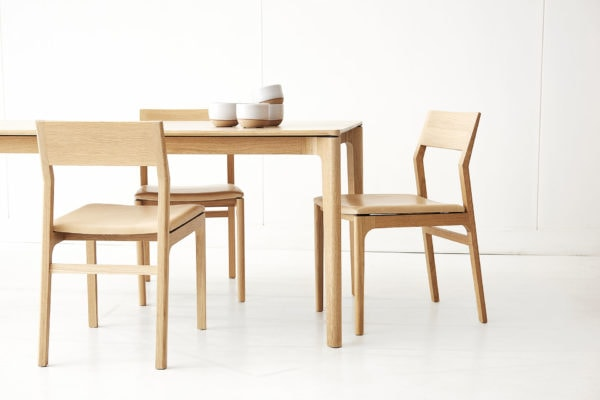 T113 table & C205 chairs shown in American White Oak