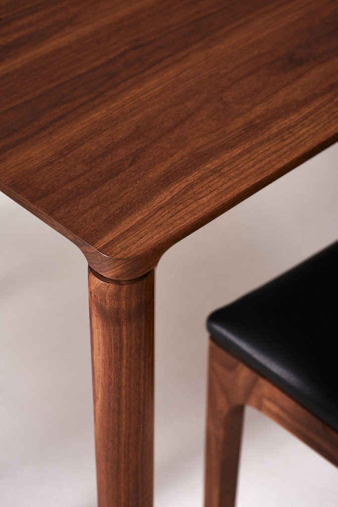 T113 table & C205 chairs shown in American Black Walnut
