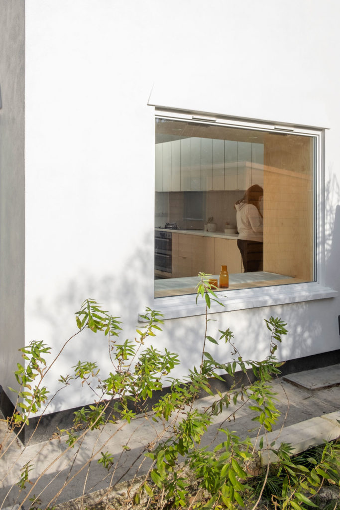 The Nook House - a window seat and subterranean wine cellar extension to a family home in London