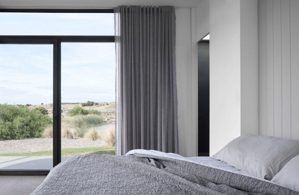 Torquay Beach House, a new contemporary home celebrating raw concrete and exposed brick
