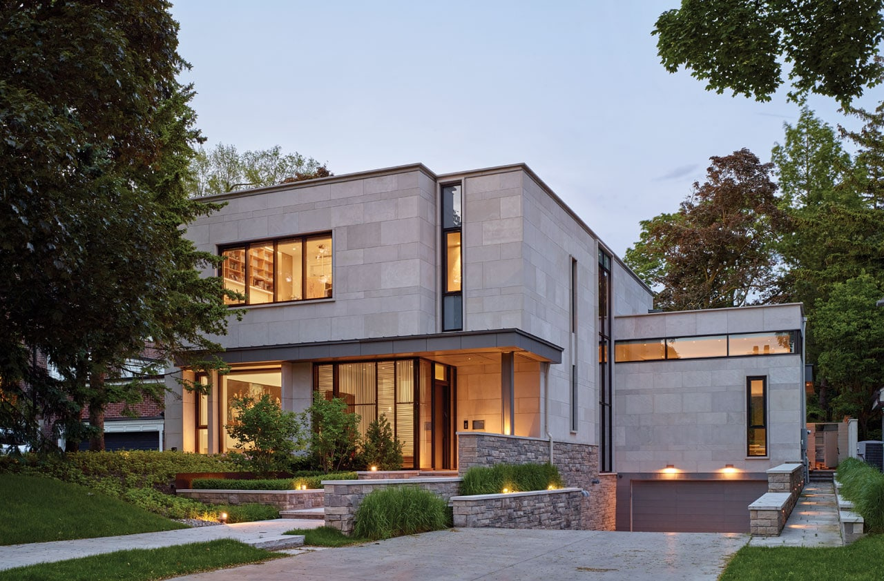 Exterior clad in large slabs of Indiana Limestone with a base of split faced Ontario Algonquin stone.