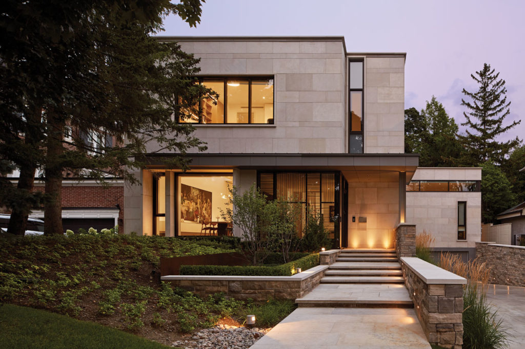 Exterior clad in large slabs of Indiana Limestone with a base of split faced Ontario Algonquin stone